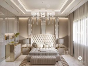 Luxury master bedroom with gray color walls, a large bed, lacquer and gold finish.