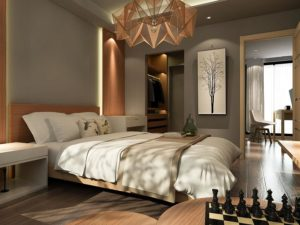 Bedroom interior decoration with wooden cladding and LED lighting on the headboard.